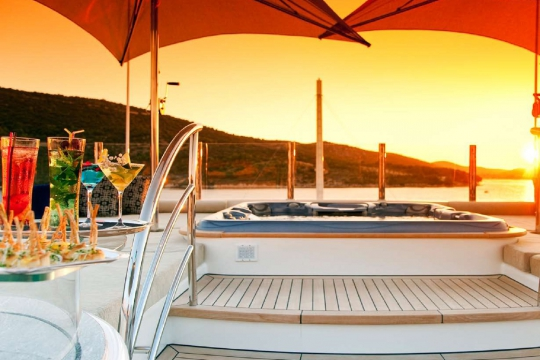 Motor Yacht Mary-Jean II Isa for charter - bridge deck jacuzzi sunset