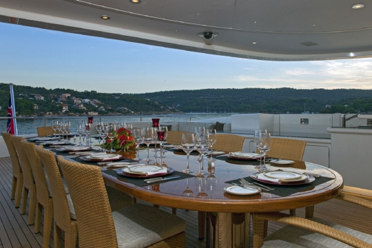 Motor Yacht Mary-Jean II Isa for charter - bridge deck dining table aft