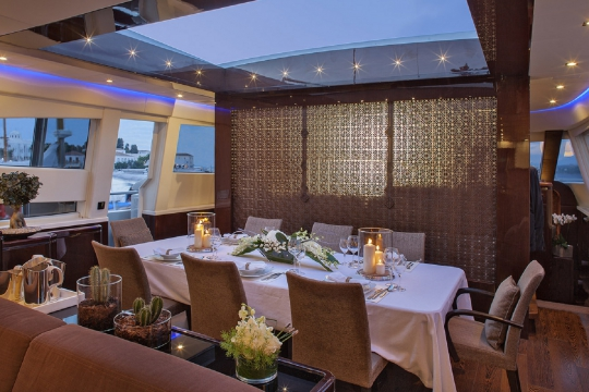 Motor Yacht My Toy AB yachts for charter - dining room open roof top