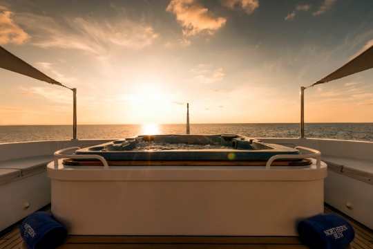 Motor Yacht Northern Sun for charter - sundeck jacuzzi sunset