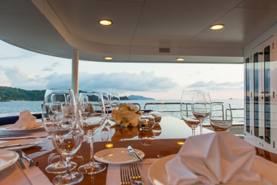 Motor Yacht Northern Sun for charter - main deck dining table.jpg