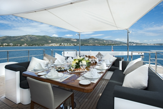 Motor Yacht Christina G Kingship for charter - bridge deck exterior dining table