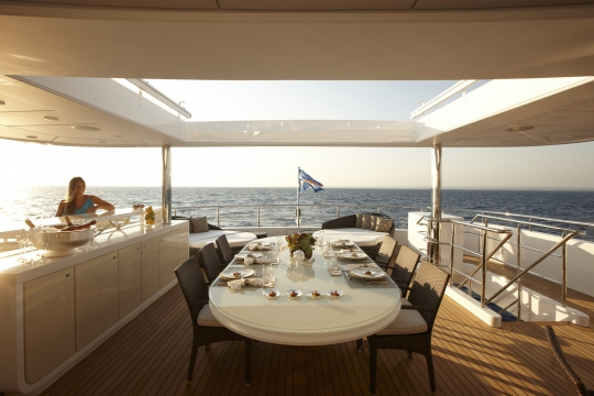 Motor Yacht E&E for charter - upper deck dining table 2
