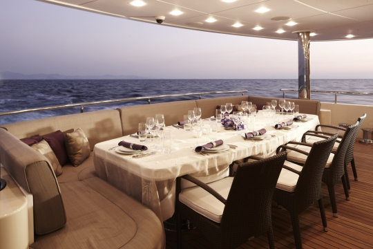 Motor Yacht E&E for charter - aft main deck dining table