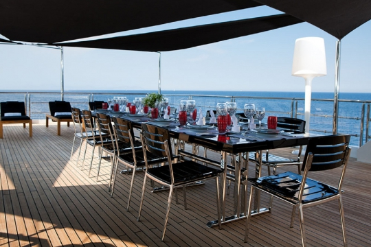 Motor Yacht Idol for charter - sundeck dining table